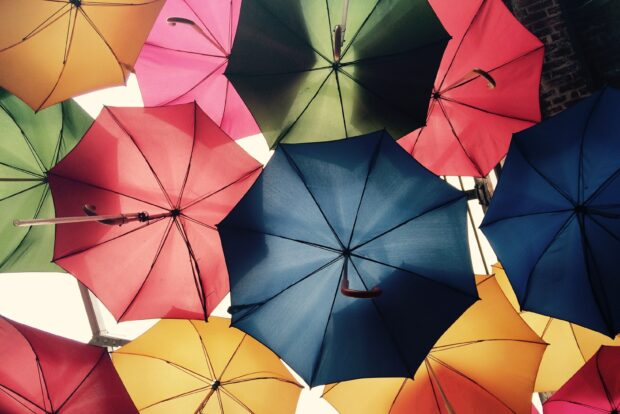Many umbrellas are open and photographed from underneath.